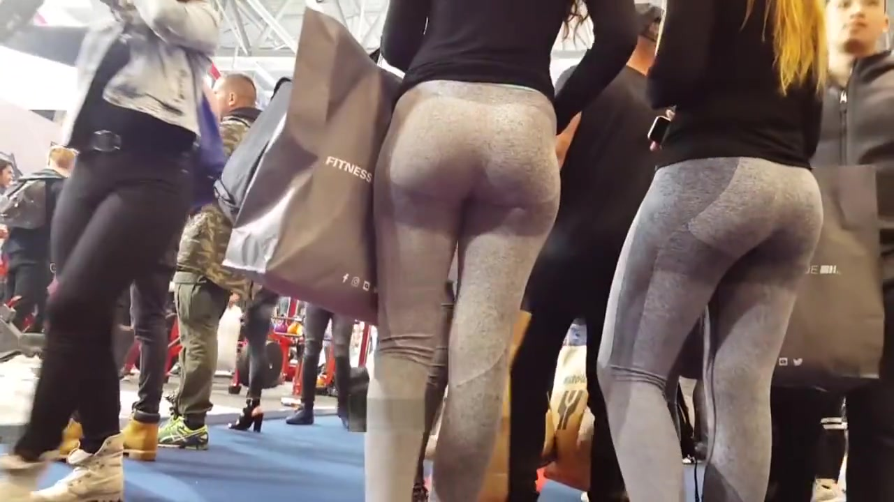 Two candid fit asses in grey yoga pants walking Eastwest the dark side